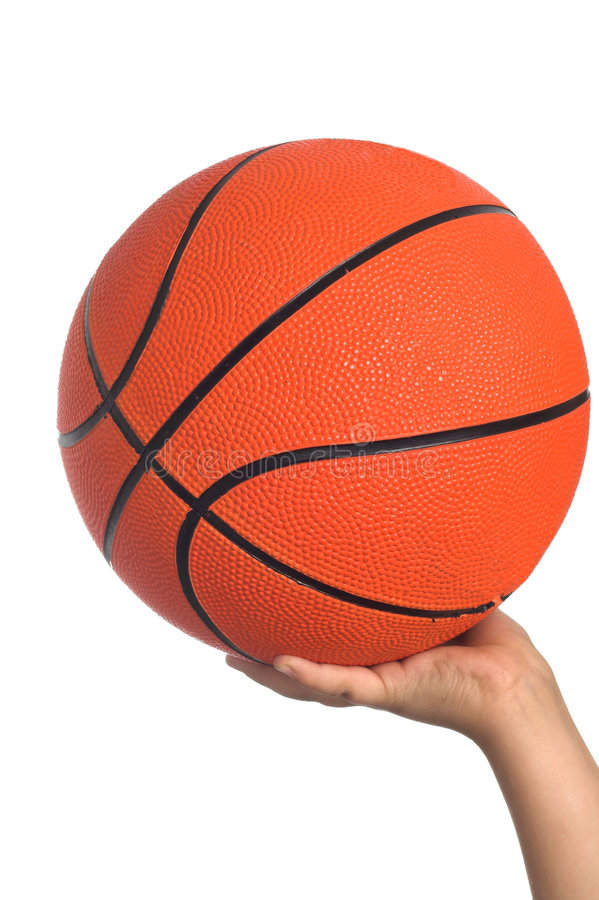 Basketball in hand stock photography