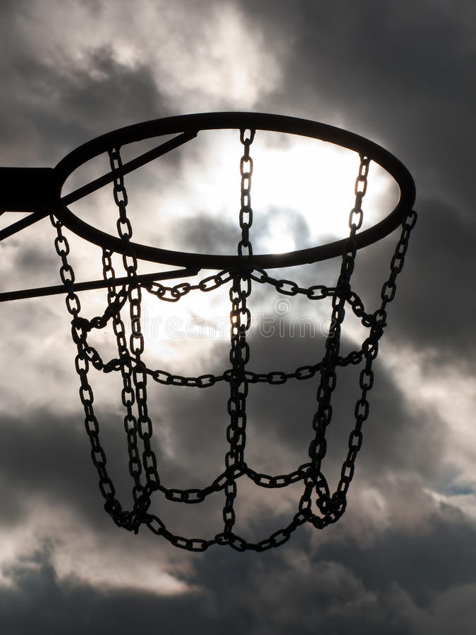 Basketball hoop. Team playing sport basketball hoop and net on sky royalty free stock images