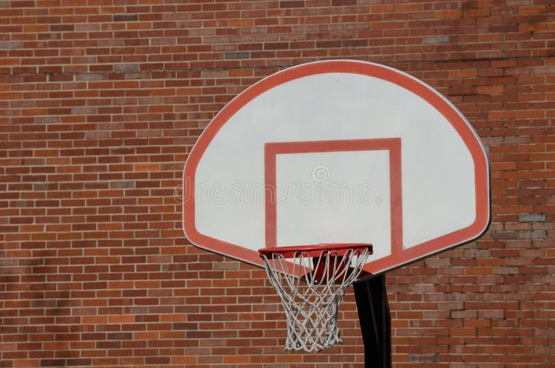 Basketball Hoop. Urban basketball hoop and backboard against a brick wall stock photo