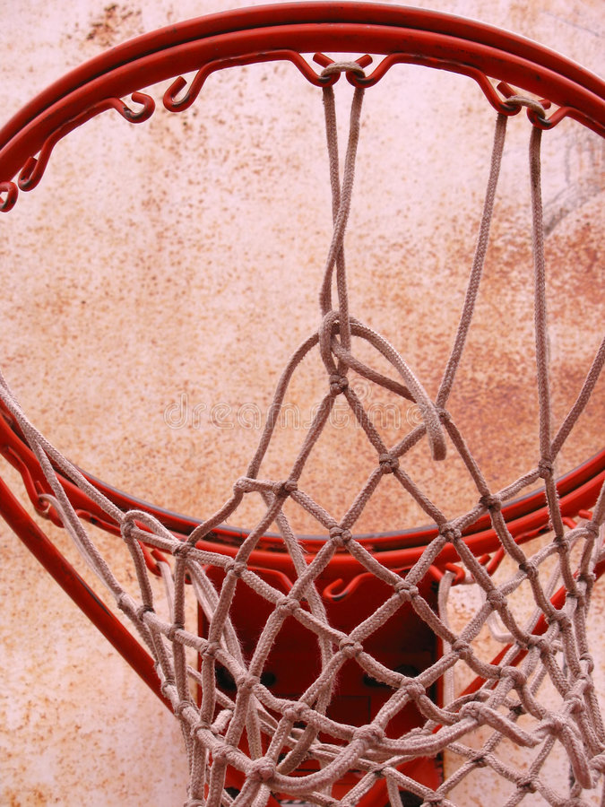 Basketball hoop. A closeup of a playground basketball goal and net royalty free stock photography