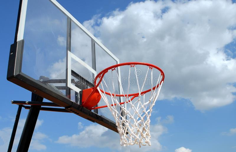 Basketball hoop against blue skies stock photography
