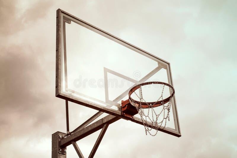 Basketball hoop against a rainy sky stock photos