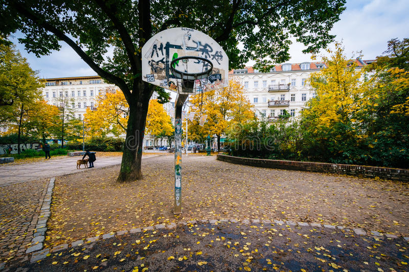 Basketball hoop and autumn color at Helmholtzplatz, in Prenzlauer Berg, Berlin, Germany. stock photo