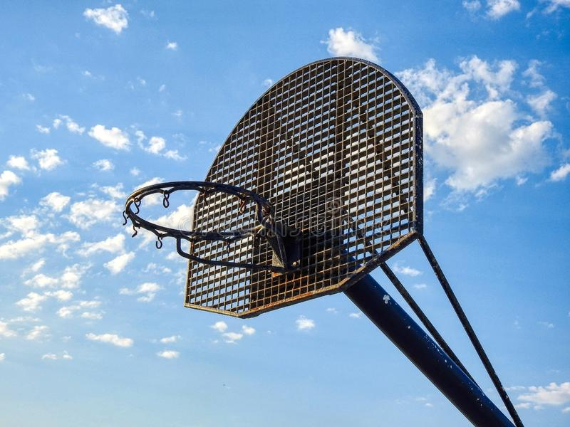 Basketball Hoop. Basketball hoop and backboard against clear blue sky in background royalty free stock photo