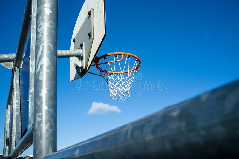 Basketball hoop on a background of blue sky. royalty free stock image