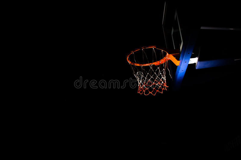 Basketball hoop. On black background with light effect stock photos