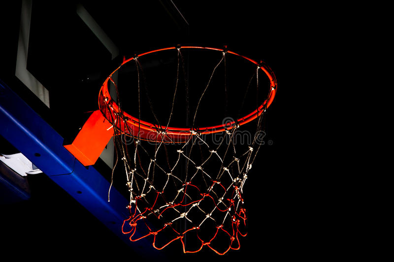 Basketball hoop. On black background with light effect stock images