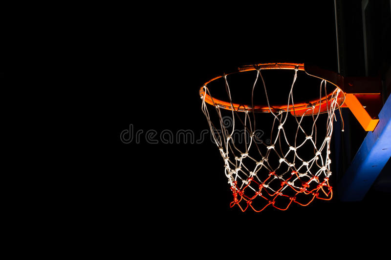 Basketball hoop. On black background with light effect royalty free stock image