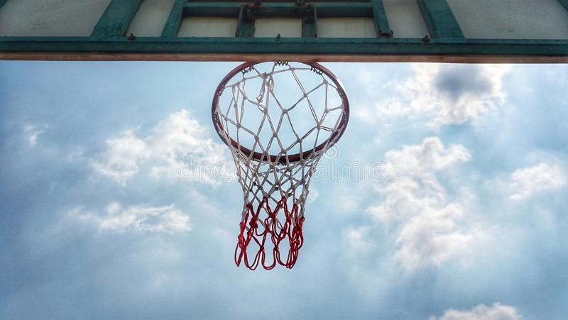 Basketball hoop and blue sky. Background royalty free stock photos