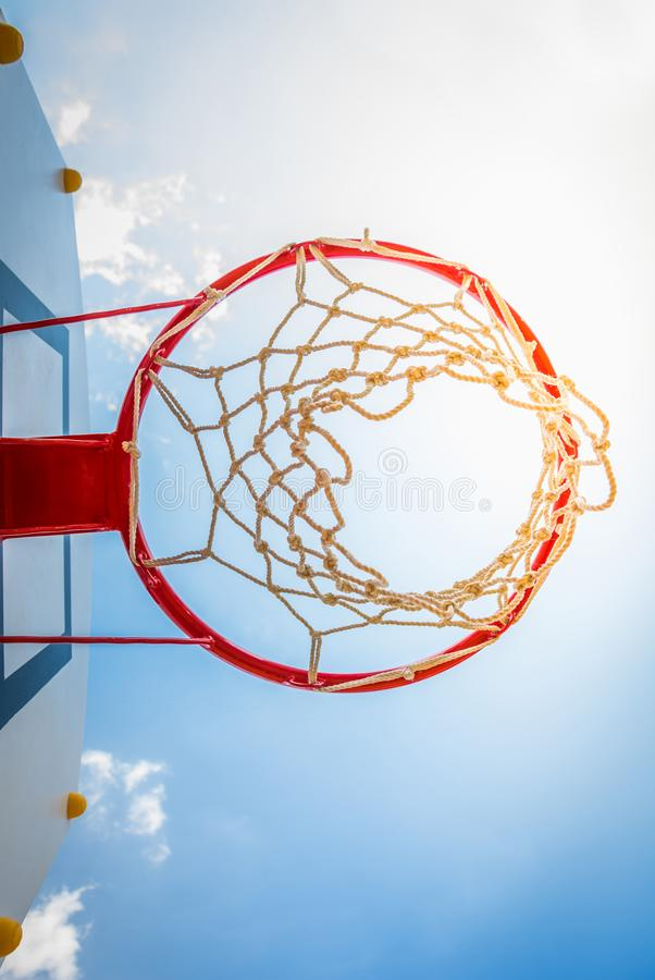 Basketball hoop with blue sky. stock images
