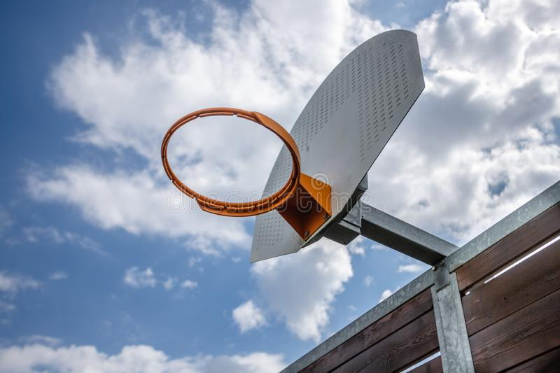 Basketball hoop with a cloudy sky stock photo