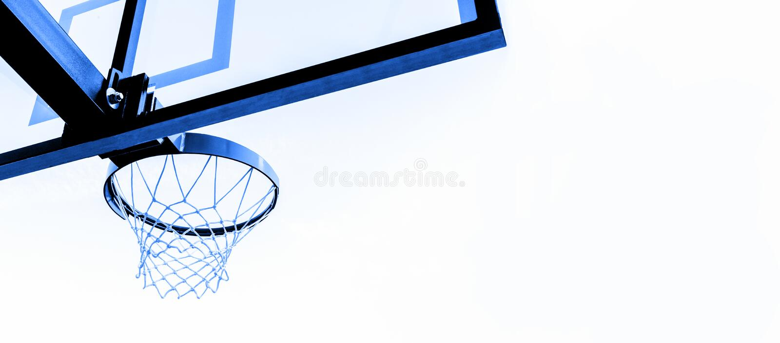 Basketball hoop isolated on white background. Blue filter royalty free stock photography