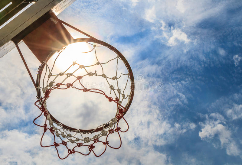 Basketball hoop. Looking up basketball hoop with a blue sky royalty free stock photos