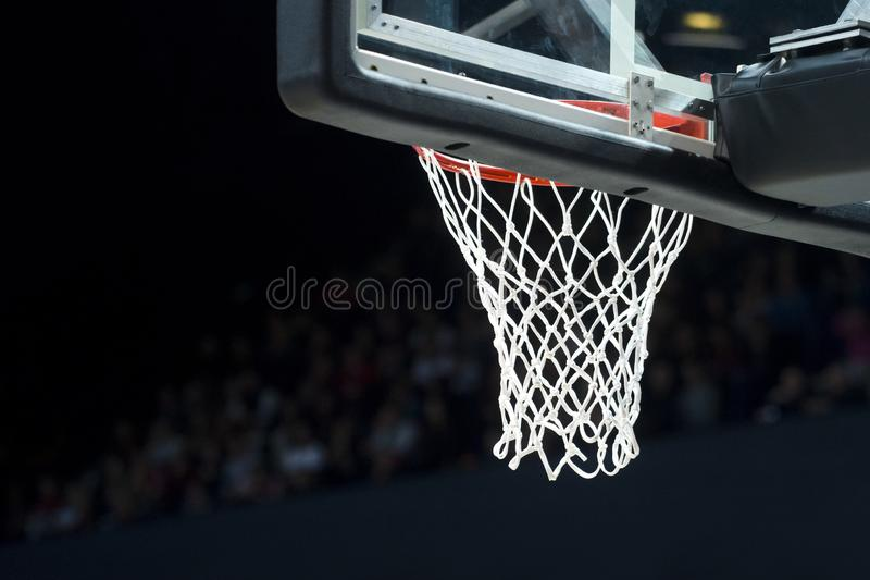 Basketball hoop with net on black background royalty free stock photo