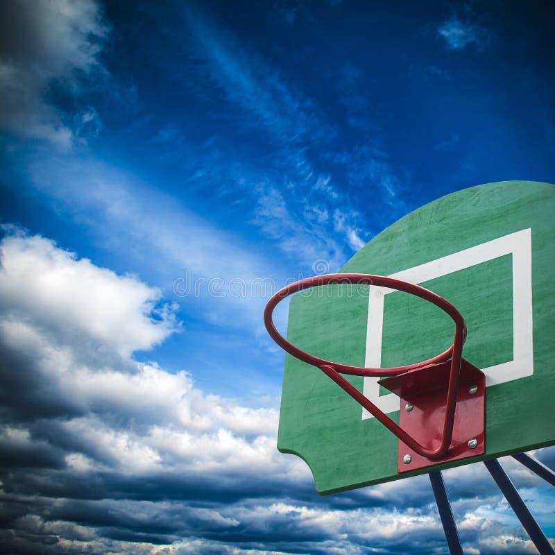 Basketball hoop. A basketball hoop at the playground stock photos