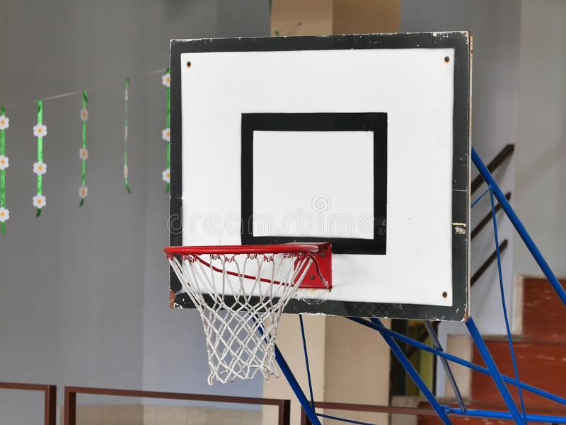 Basketball hoop school indoor gym.  stock images