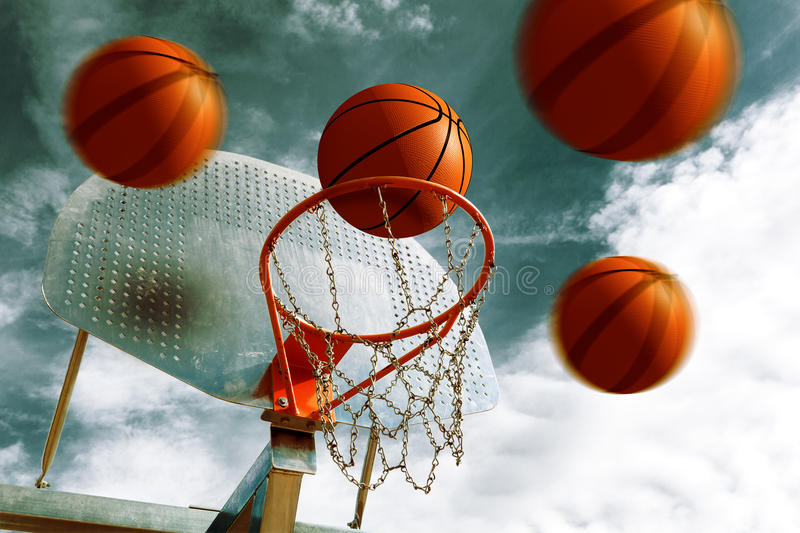 Basketball hoop. Basketball hoop and several balls over blue sky. Sport background royalty free stock photo