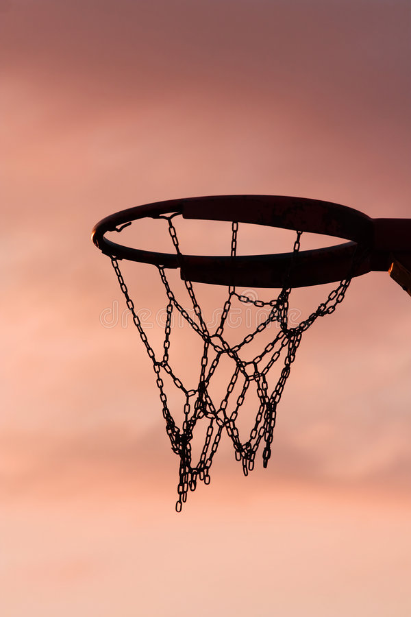 Basketball hoop in sunset royalty free stock image