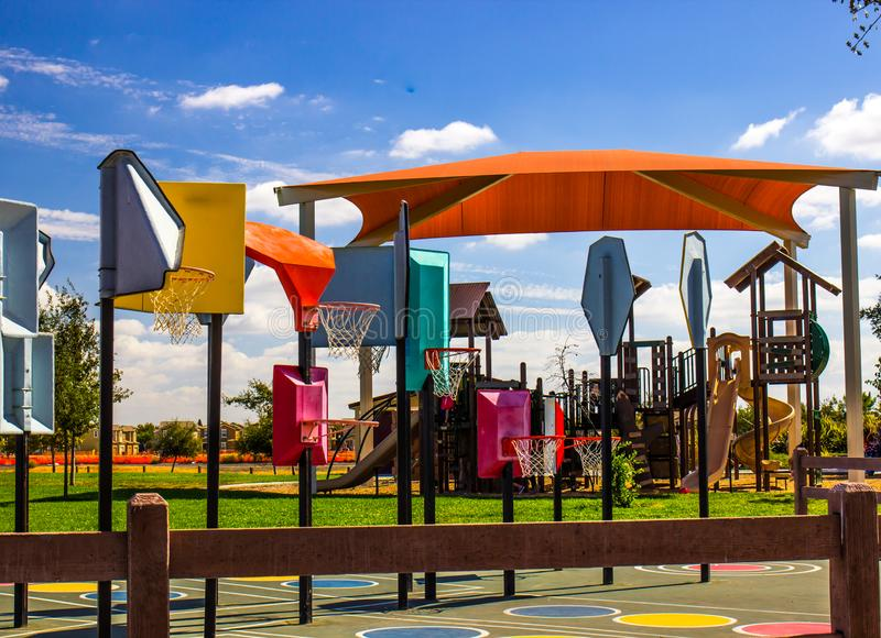 Basketball Hoops For Different Levels At Local Playground royalty free stock image
