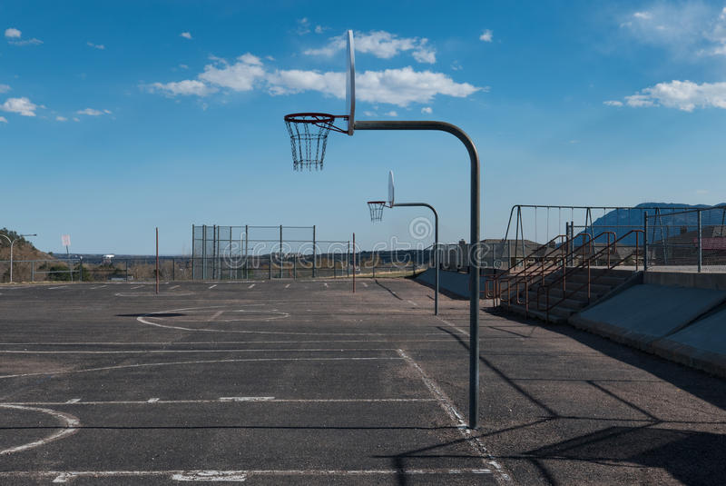 Basketball Hoops on a Playground. Basketball Hoops and an Empty Court in Colorado Springs royalty free stock photo