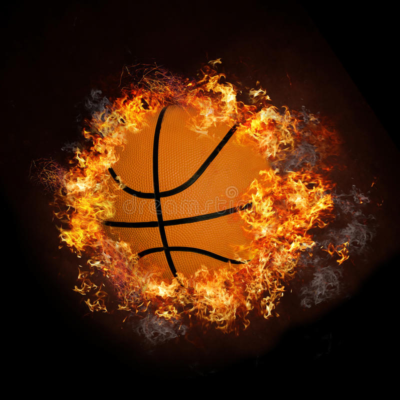 Basketball on hot fire smoke stock photo