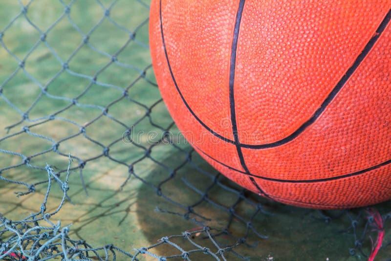 Basketball Indoor Stadium. Low-Key Photo. Basketball placed at the indoor stadium. Low-Key Photo royalty free stock images
