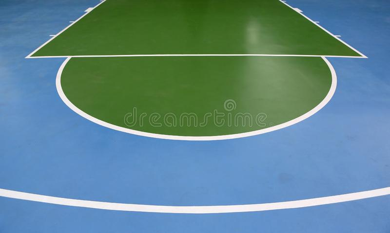 Basketball lines on an outdoor court.  royalty free stock image