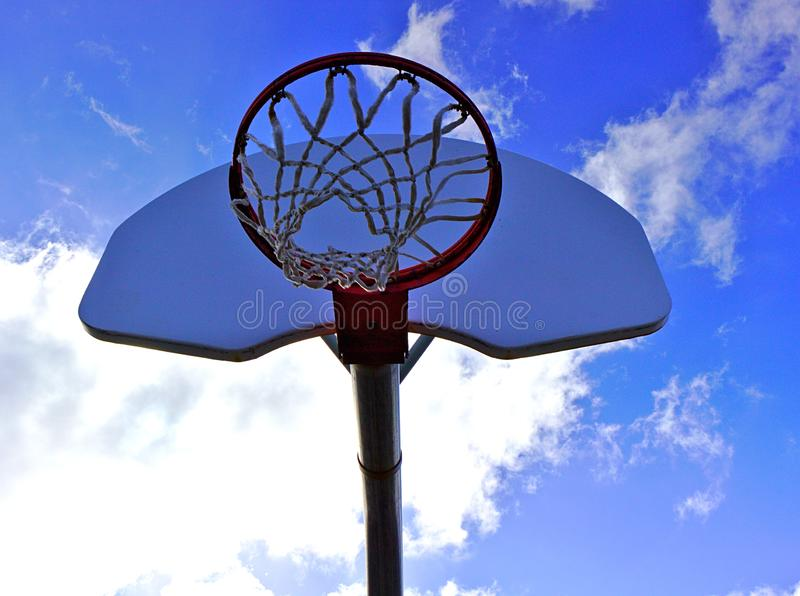 Basketball net and blue sky  stock photography