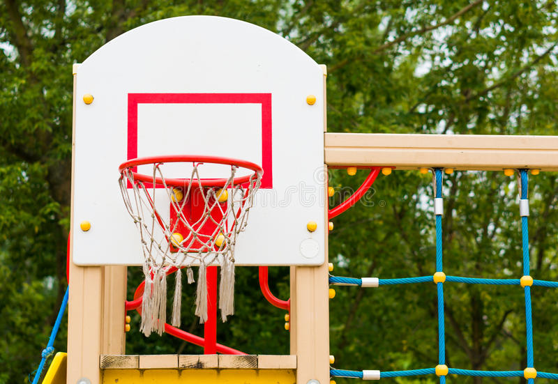 Basketball net and hoop. Attached to a backboard at a playground royalty free stock image