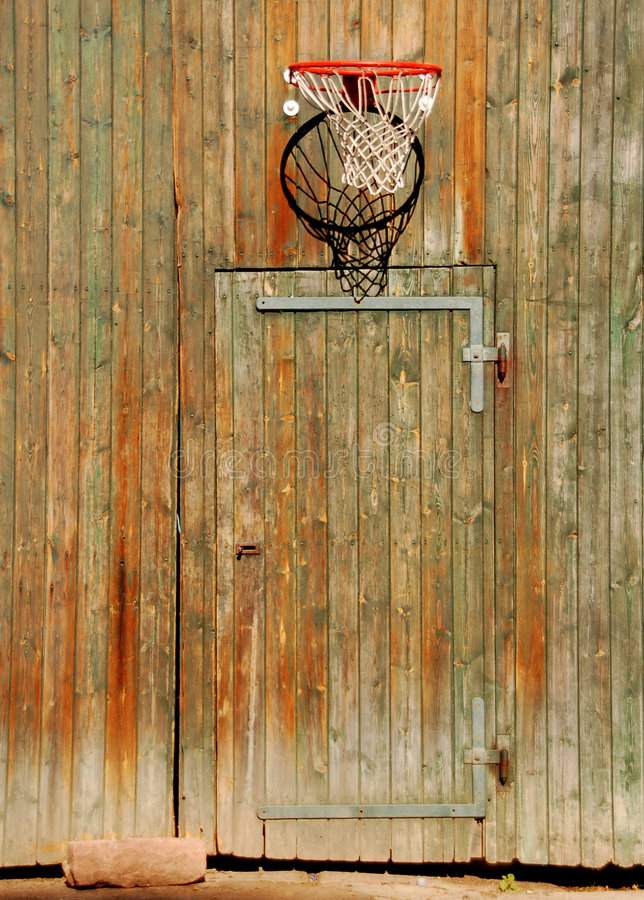 Free Basketball Net On Ancient Door Royalty Free Stock Photography - 3392087
