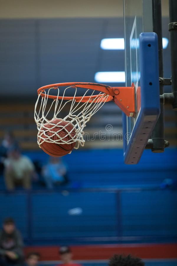 Basketball in net for score royalty free stock photos