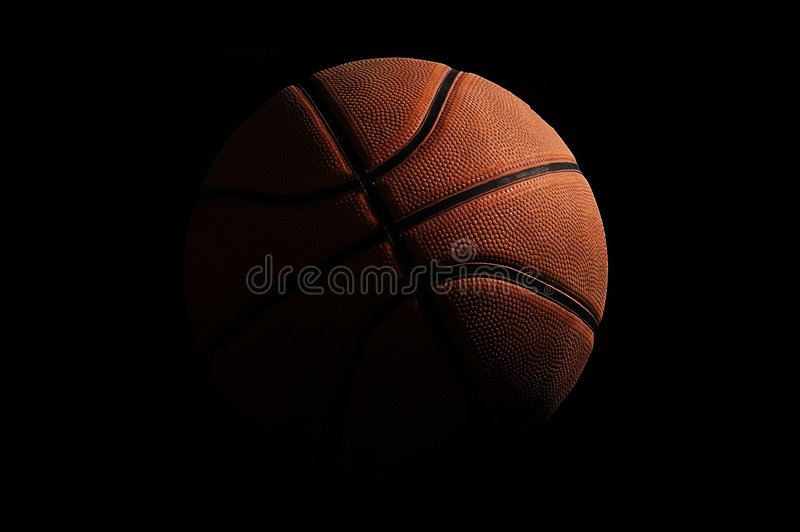 Basketball over black background royalty free stock photography