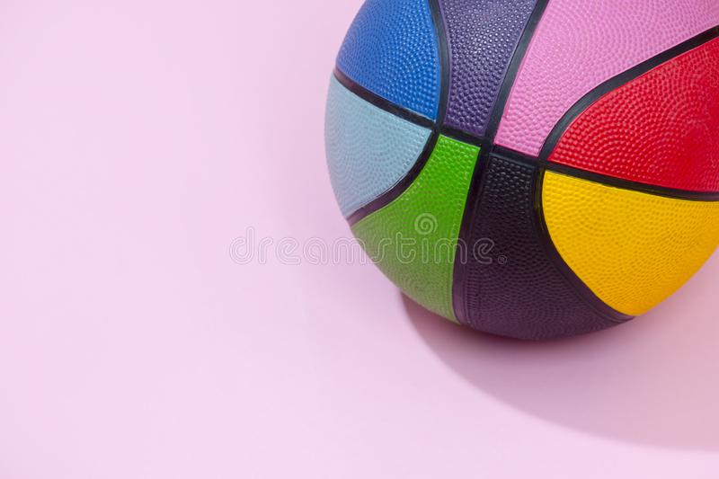 Basketball on pink background as a sports and fitness symbol of a team leisure activity playing with a leather ball dribbling and royalty free stock image