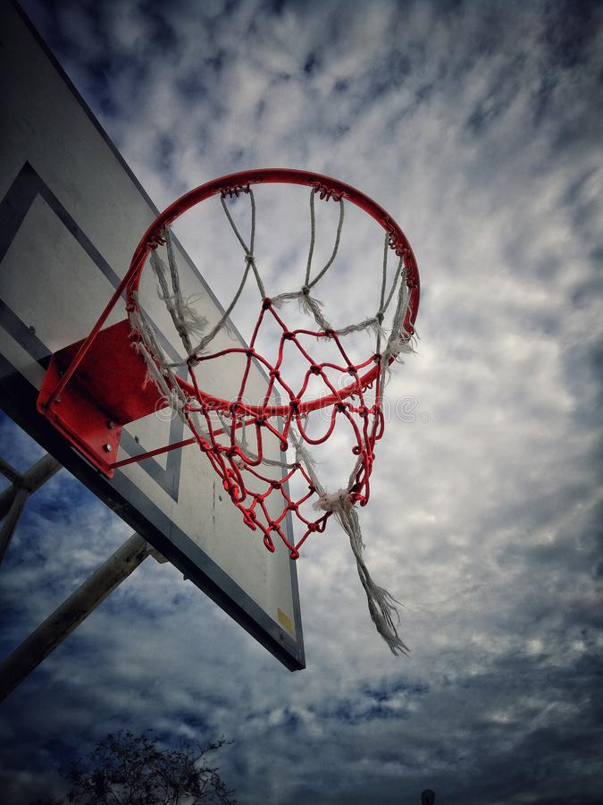 Basketball pitch in the field informing the dark sky. stock photos