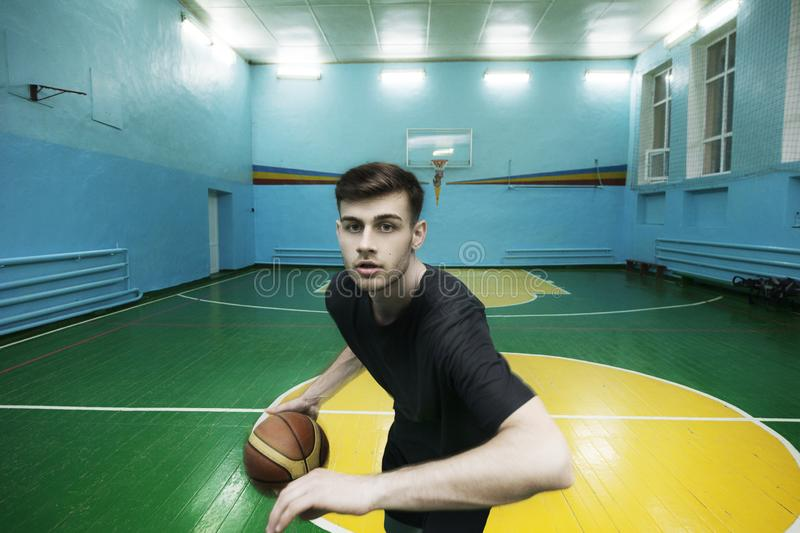 Basketball player in action in a basketball court royalty free stock photo