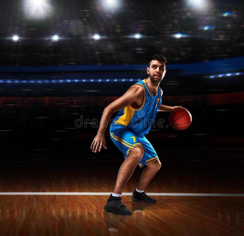 Basketball player in action on basketball playground stock images
