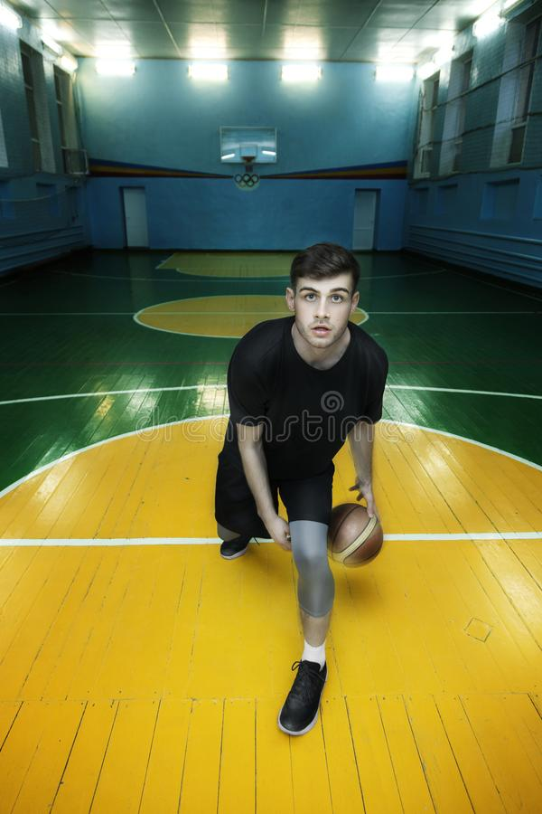 Basketball player in action in a basketball court royalty free stock photography