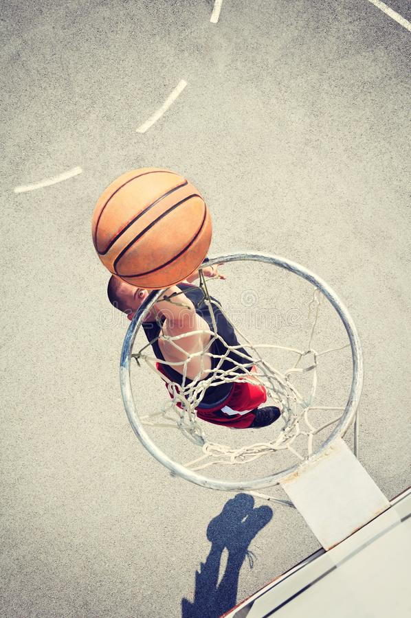 Basketball player in action flying high and scoring royalty free stock images