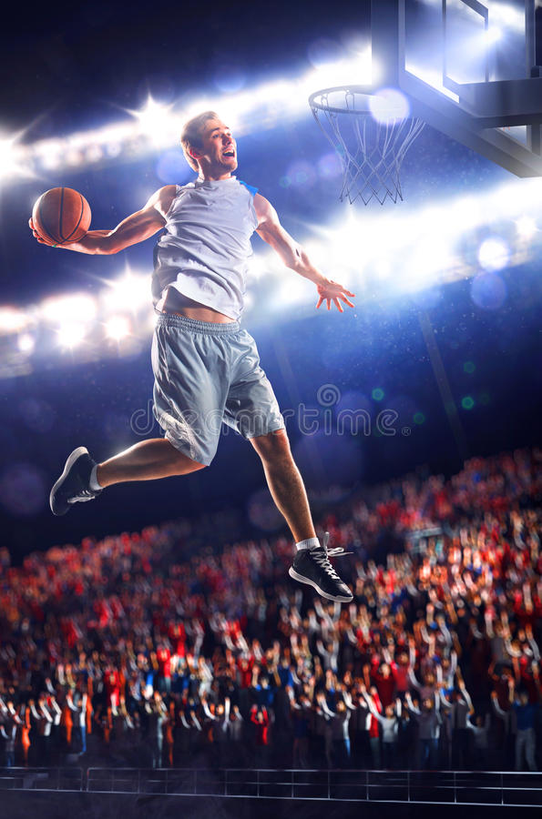 Basketball player in action is flying high stock photography