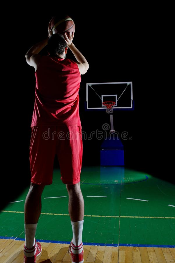 Basketball player in action. Basketball game sport player in action isolated on black background stock images