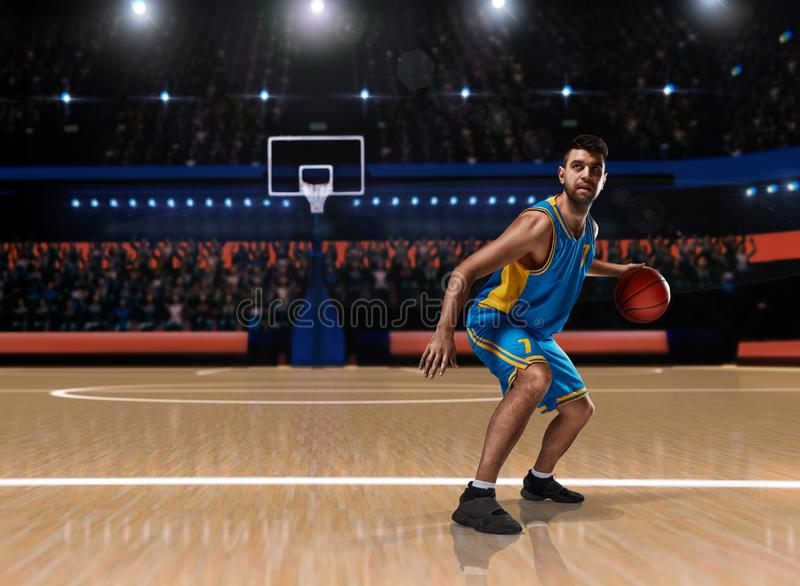 Basketball player in action on basketball playground royalty free stock photo