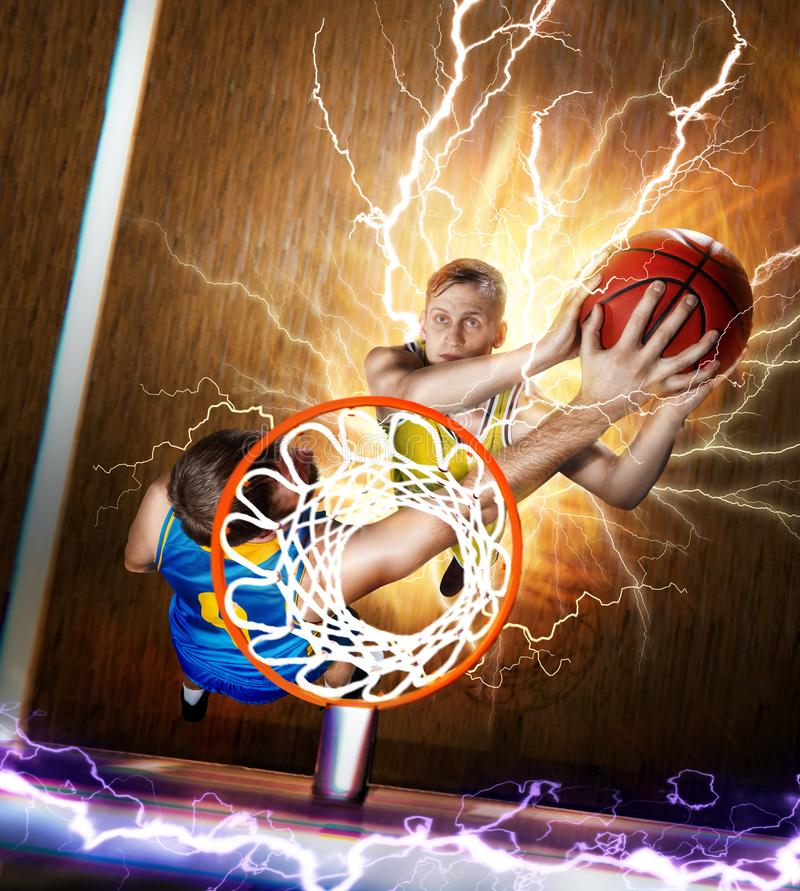 Basketball player is blocking shot under the basket royalty free stock images