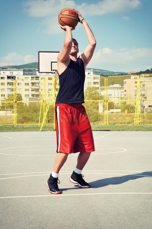 Basketball player concentrate and preparing for shoot stock photo