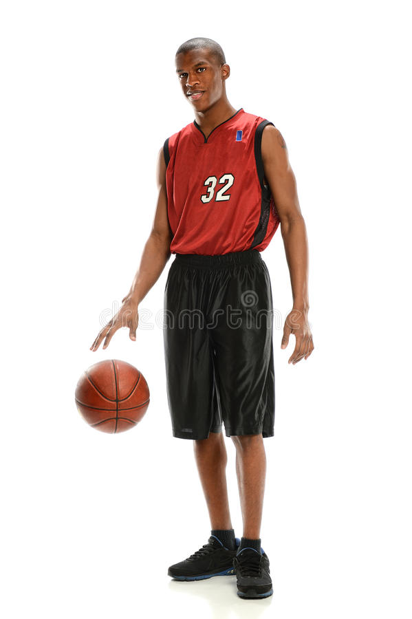 Basketball Player Dribbling Ball. Young African American basketball player dribbling ball isolated over white background royalty free stock photo