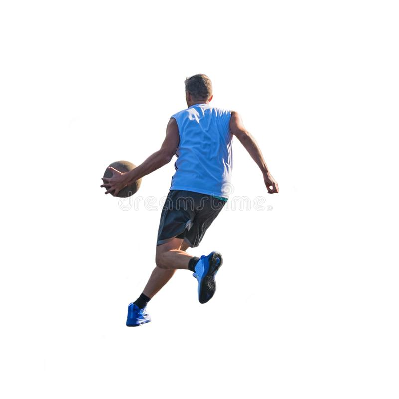 Basketball player dribbling to the basket. Seen from behind stock photo