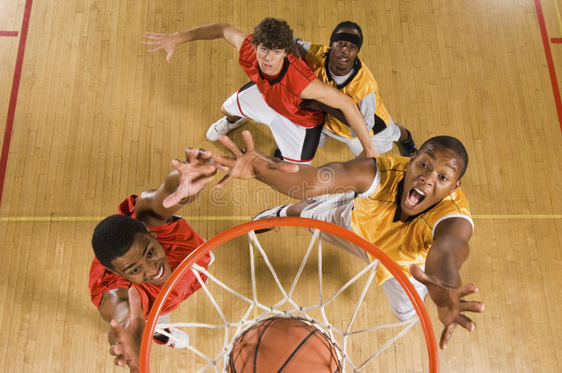Basketball Player Dunking Basketball In Hoop. High angle view of basketball player dunking basketball in hoop royalty free stock images