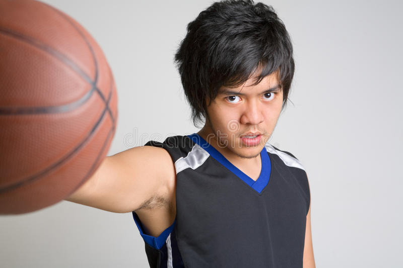 Download Basketball Player Holding The Ball Stock Image - Image of background, game: 9818451