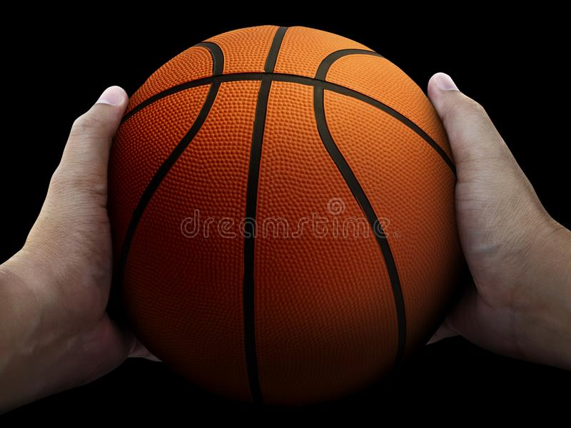 Basketball player holding a ball against black background. For design In the media Advertising stock photography