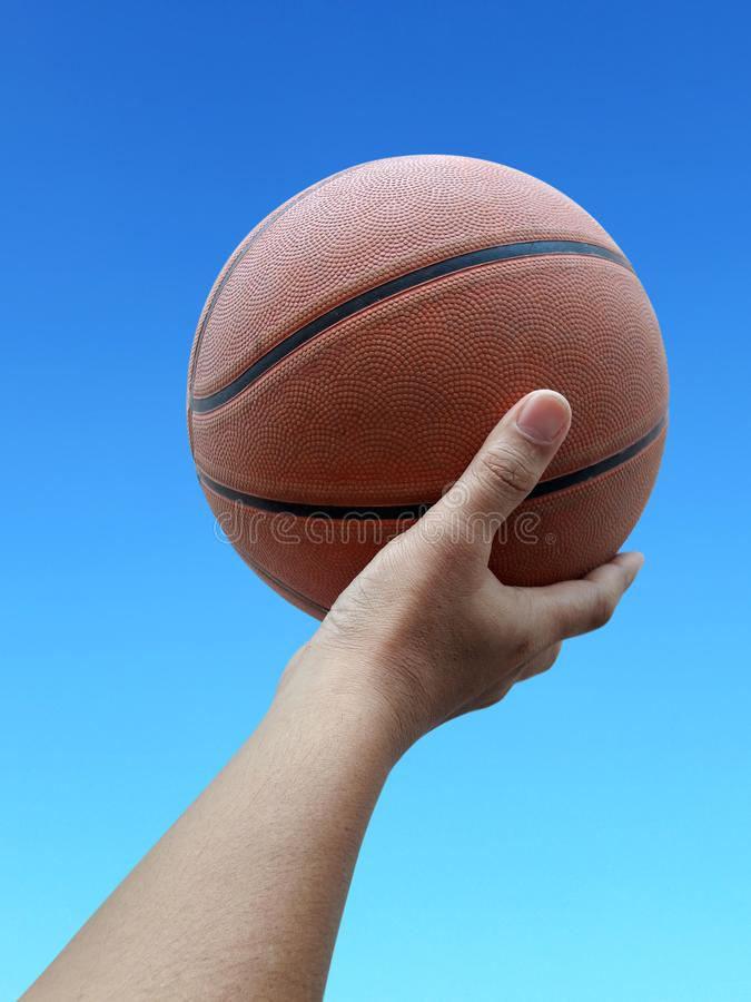 Basketball player holding a ball against sky background. For design In the media Advertising royalty free stock photos