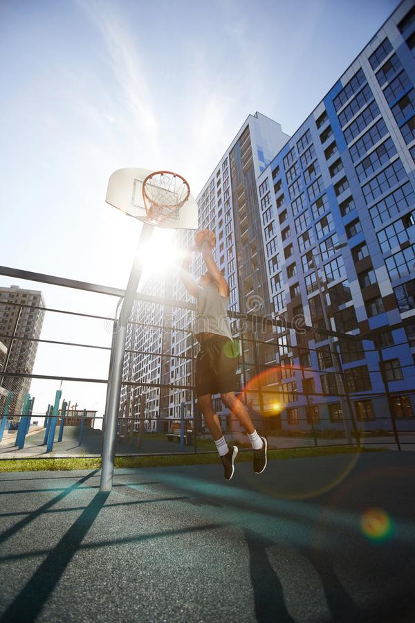 Basketball Player Jumping in Sunlight stock afbeelding
